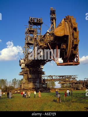 Bucket wheel excavator travelling to neighbouring mine, Germany. - Stock Photo