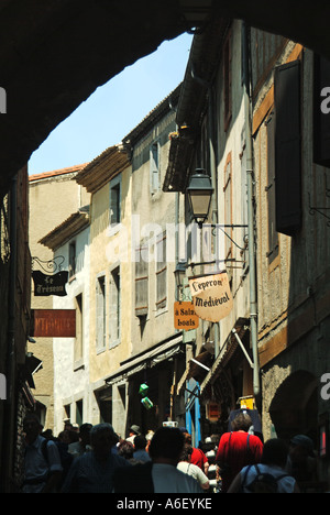 Carcassonne fortified medieval town typical narrow street crowded with tourists - Stock Photo