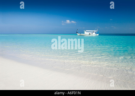 Dhoni Boat desert island sandbank The Maldives - Stock Photo