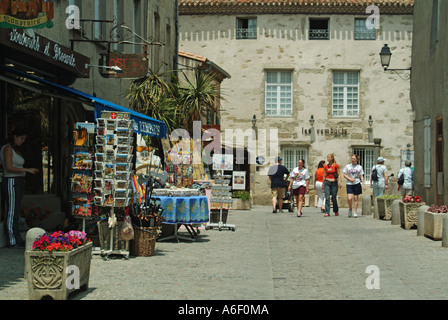 Carcassonne fortified medieval town typical street with shops and tourists - Stock Photo