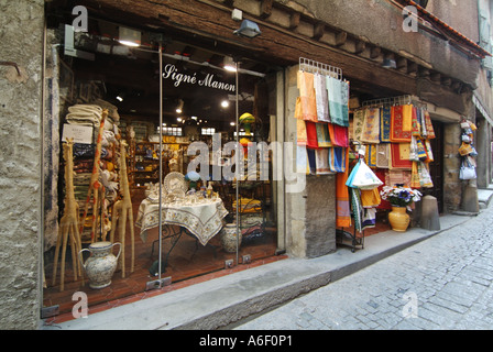 Carcassonne fortified medieval town typical narrow street with shop front display - Stock Photo