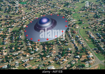 UFO over the suburbs - Stock Photo