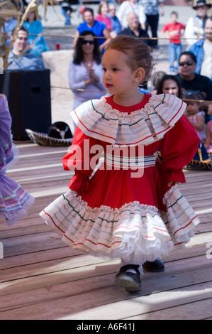 Young hispanic New Mexican folk dancers at El Rancho de Las Golondrina, New Mexico - Stock Photo