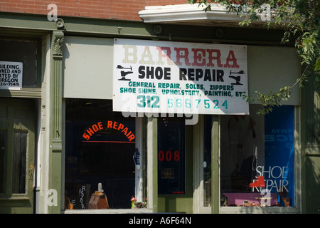 ILLINOIS Chicago Exterior of shoe repair store signs in English and Spanish Pilsen neighborhood on near south side - Stock Photo