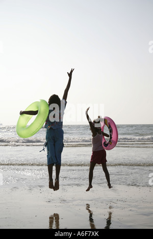 South Asian Indian boy and girl with safety swimming equipment Shiroda Dist Sindhudurga Maharashtra India - Stock Photo