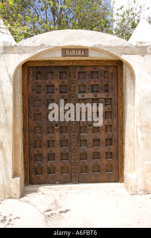 Intricately carved traditional Swahili door in Lamu Kenya East Africa - Stock Photo