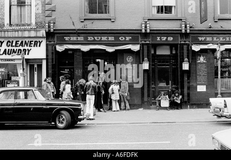 Hippies outside pub in Notting Hill Gate 1975.