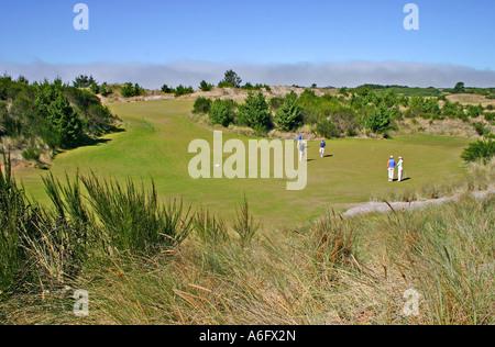 Golfers at Bandon Trails Golf Course in Bandon Dunes Golf Resort Bandon Oregon - Stock Photo