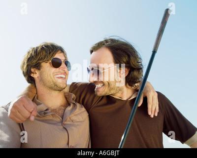 Happy male golfers - Stock Photo