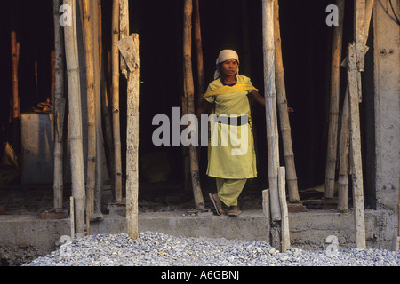 female construction worker on building site, Nepal, Pokhara - Stock Photo