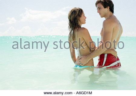 Couple standing in the sea - Stock Photo