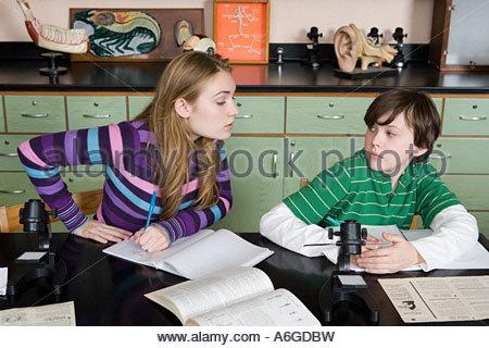 Girl copying boy in class - Stock Photo
