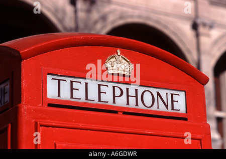 Curved top of a classic red British telephone box (K6 model), London, England - Stock Photo