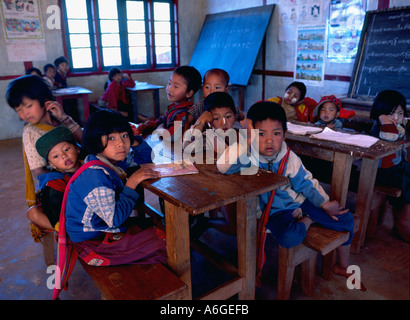 Shan State Kalaw District Village of Myindaik young children at schoolbench in classroom - Stock Photo