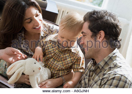 Parents and little boy with soft toy - Stock Photo