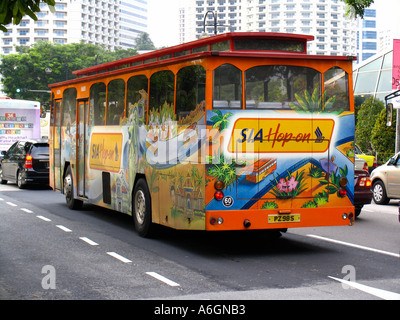 Hop On air conditioned tourist trolley bus Singapore - Stock Photo