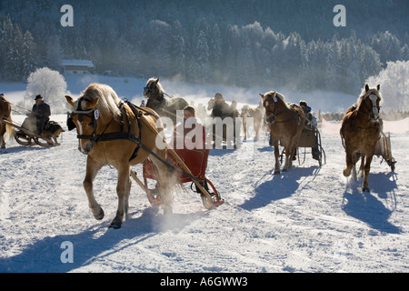 Horse drawn sleigh racing in Rottach-Egern Upper Bavaria Germany - Stock Photo