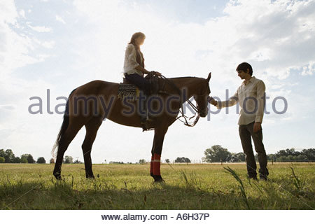 Couple with a horse - Stock Photo