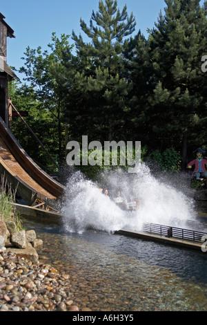 Pirate Falls boat flume ride with cascade splash in Legoland - Stock Photo