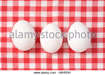 Eggs on a tablecloth - Stock Photo