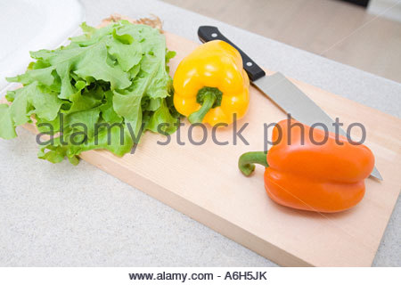 Vegetables and knife on a cutting board - Stock Photo