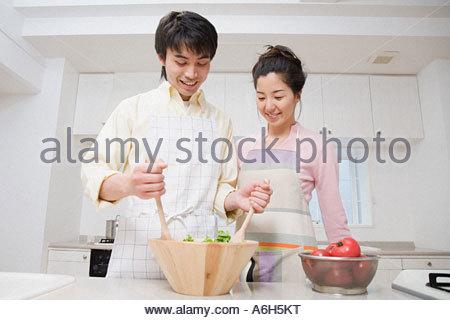 Couple preparing meal - Stock Photo
