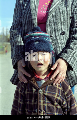 Portrait of a small girl with mother. Toora-Khem village. The Tyva (Tuva) Republic. Russia - Stock Photo