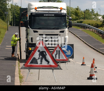 roadworks on a street in England - Stock Photo