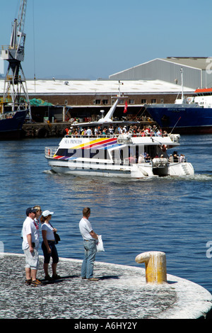Port of Cape Town South Africa. Robben Island catamaran ferry underway Tourists watching - Stock Photo