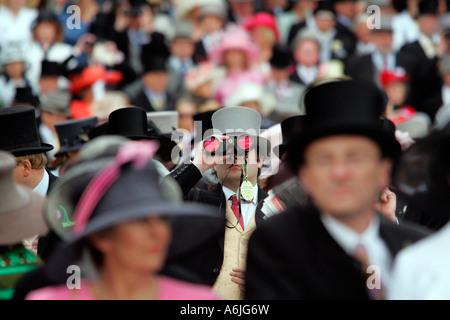 Man at Royal Ascot horse race, looking through binoculars, York, Great Britain - Stock Photo