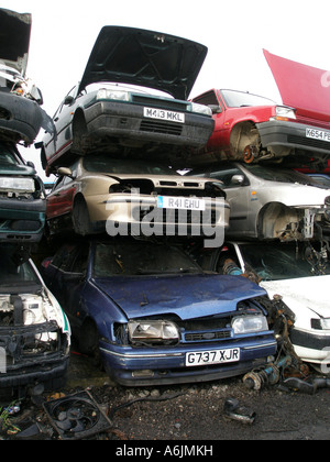 cars stacked up in a  scrap yard - Stock Photo
