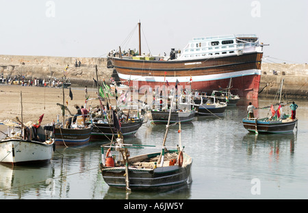 Dhow and fishing boats at Mandavi Port in Gujarat India - Stock Photo