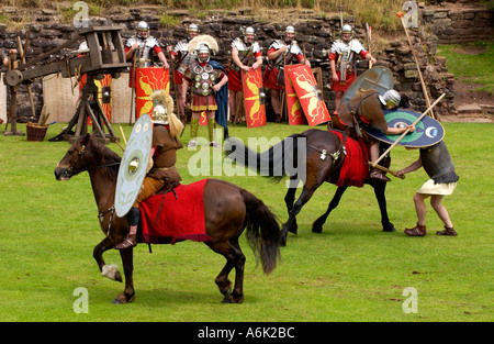 Cavalry of the Ermine Street Guard give a display of fighting skills in the Roman Amphitheatre at Caerleon Gwent - Stock Photo