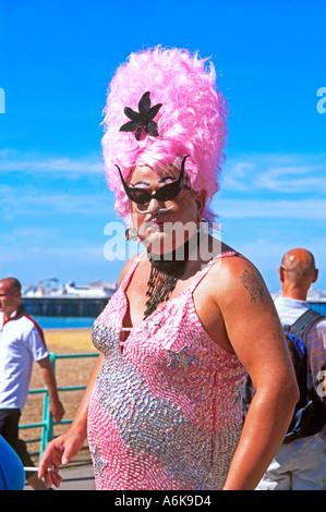 Pink participant on parade at Gay Pride Brighton UK 2004 - Stock Photo