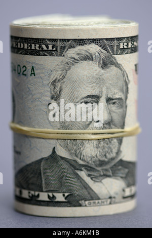 US currency roll of fifty dollar bills close up - Stock Photo