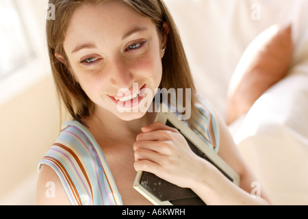 Girl holding picture frame - Stock Photo
