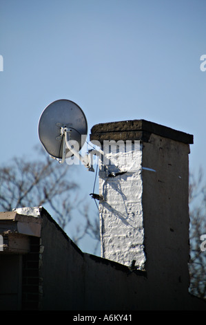Satellite dish on roof New York City USA US United States of America - Stock Photo