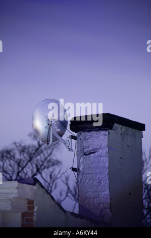 Satellite dish on roof New York City USA US United States of America - Stock Photo