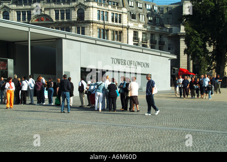 Tower Hill remodelled approach areas to the Tower of London early morning queues waiting for ticket booths to open - Stock Photo