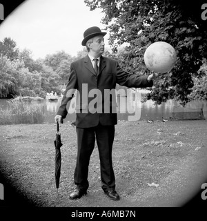 City gent with globe in his hands - Stock Photo