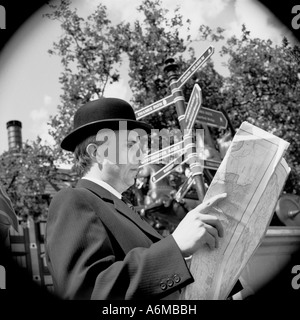 Man reading map in London - Stock Photo