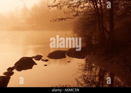 Early Morning Mist over Liden Lagoon - Stock Photo