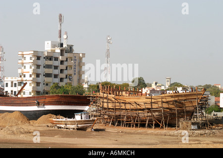 Dhow building at Mandavi Port in Gujarat India - Stock Photo