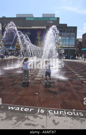 two children playing in public fountain williamson square liverpool UK 2005 - Stock Photo