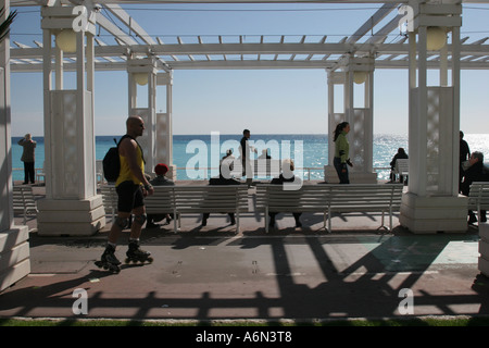 roller skater activity on the promenade des anglais, nice, cote d'azur, France people sitting on benches watching - Stock Photo