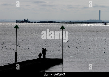 SOUTHEND ON SEA ESSEX ENGLAND. SOUTHEND ON SEA ESSEX ENGLAND PIER  FIRE RE DAMAGE RUINS FATHER SON - Stock Photo