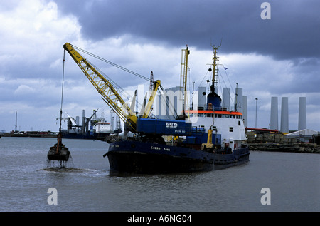 Dredger working at the Port of Lowestoft in Suffolk - Stock Photo