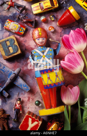 Old children's toys and pink tulips children vertical still life color colour colors colours colorful letter wooden - Stock Photo