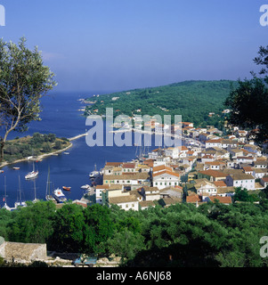 Looking down on boats and yachts in the pretty harbour and town of Gaios on Paxos the Ionian Isles Greek Islands - Stock Photo