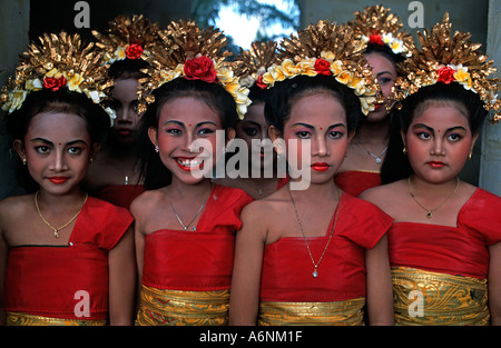A group of young brightly dressed Balinese dancers Getting ready to perform Ubud Indonesia - Stock Photo